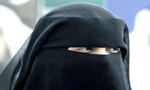 خطير : اعتقال ملتح متنكر في زي منقبة بجامع الفنا بمراكش